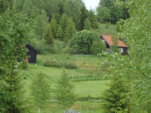 Pilegrimsovernatting med dusj og vaskemaskin i det lille huset til høyre